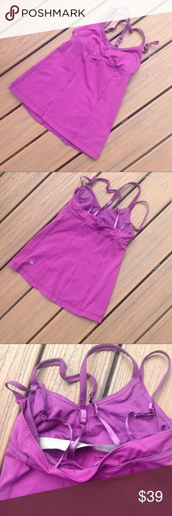 Lululemon Strap Tank Awesome lululemon tank with strappy back.  Has double bra for lots of coverage and minimal bounce.  Purple/pink color.  Minor pilling by Lulu symbol in last picture. lululemon athletica Tops Tank Tops