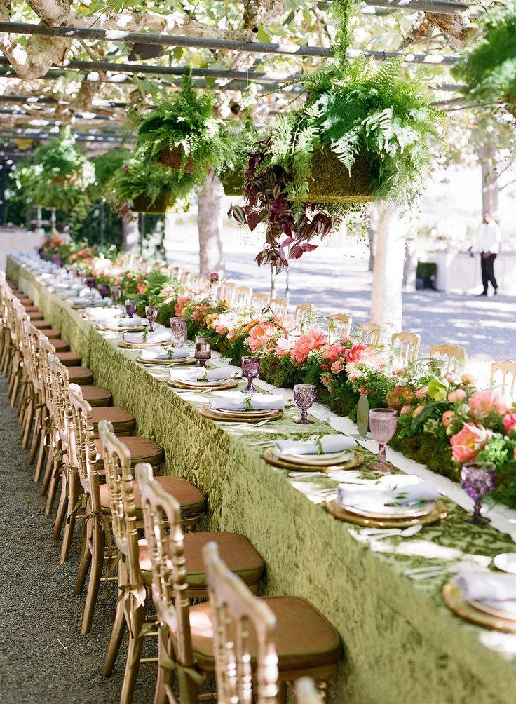 Hanging plants above a gorgeous flower runner created an intimate feeling at the wedding brunch, while the sun fell through and created gorgeous shadows over the table.