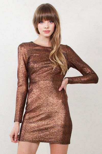 Copper metallic long sleeve body con dress with an open back. Self tie in the back. Zipper closure on back.