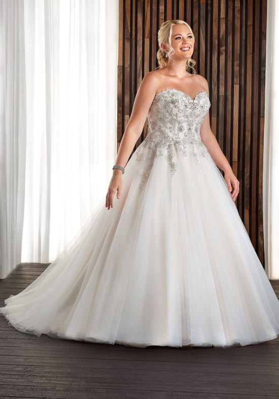 This beautiful wedding gown is showcased by a fully beaded bodice ...