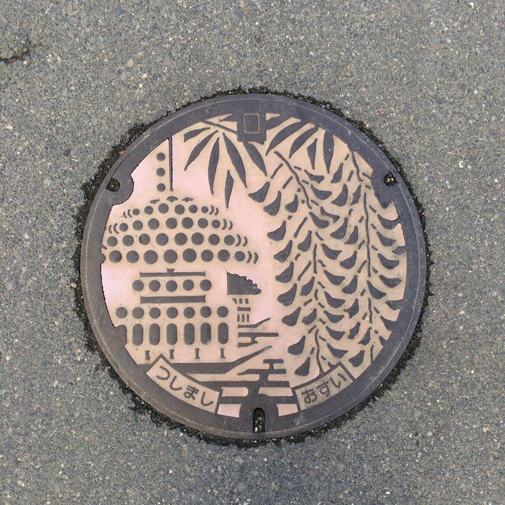 Local festival and wisteria flower manhole. Place: Tsushima city, Aichi, Japan.