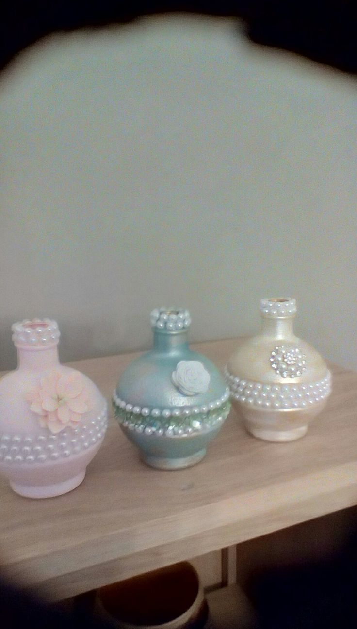 Old raspberry liqueur bottles decorated with Martha Stewart paints