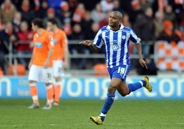 Clinton Morrison of Sheffield Wednesday celebrates scoring the opening goal during the Budweiser sponsored FA Cup Fourth Round match between Blackpool and Sheffield Wednesday at Bloomfield Road on January 28, 2012