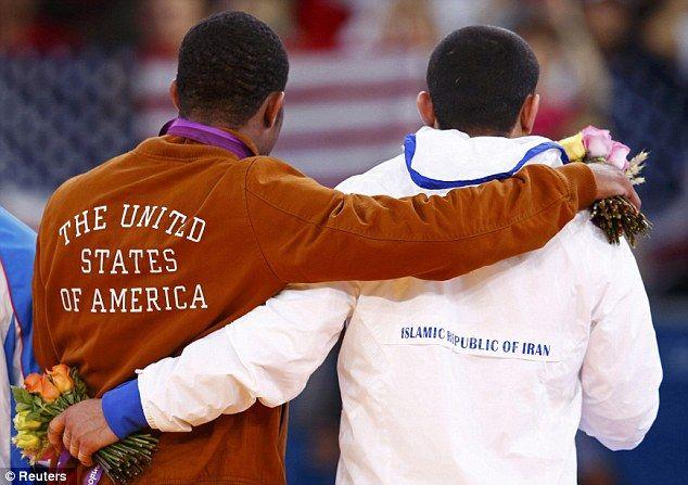 2012 Olympics wrestling  Iran's Sadegh Saeed Goudarzi (R) and Jordan Ernest Burroughs
