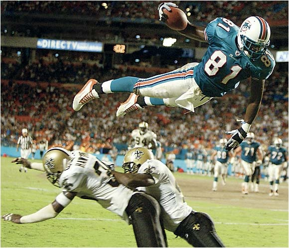 Miami Dolphins TE Randy McMichael soars above the competition in 2002. Literally.