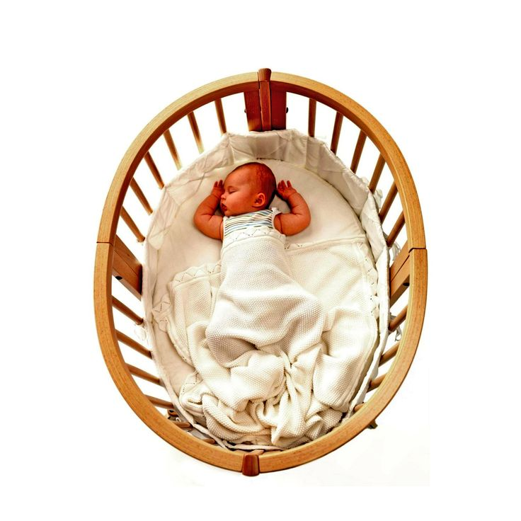 Round Cribs With Sleeping Baby