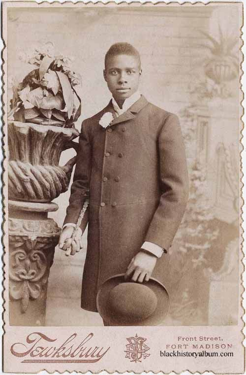 FLY GUY | 1885 Portrait, young man standing in frock coat, holding derby hat in left hand, walking stick in right. ca. 1895. Randolph L. Simpson African-American collection. Beinecke Rare Book and Manuscript Library, Yale University