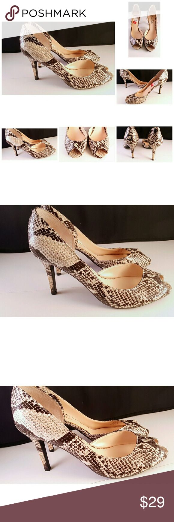 Marc Fisher Animal Print Peep Toe Stiletto Heels Marc Fisher Animal Print Peep Toe Stiletto Heels Women's Size 9.5 Cream Brown  Excellent Condition  Condition Rank 9.5 - Store Display May have been tried on but not purchased. Thanks We Ship Fast Marc Fisher Shoes Heels