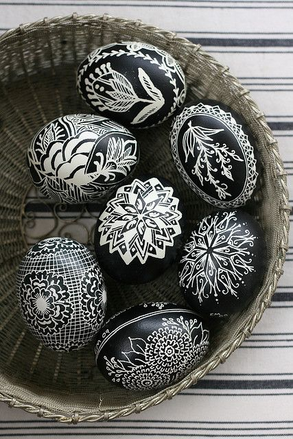 Pinner said: my ukrainian grandmother taught me how to make eggs like this when I was young. use melted wax to draw a design on the eggs, allow it to dry, then dip the egg into dye. once finished dying, allow to dry, then warm the wax (she did this over a candle flame), and wipe the wax off with a towel. if you blow the egg insides out beforehand, then the eggs will last forever!