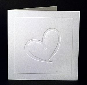 Calligrapher Heart Wedding Invitation - A classic square invitation embossed with a simple heart. It is printed on the inside and fits into a square envelope. www.kardella.com