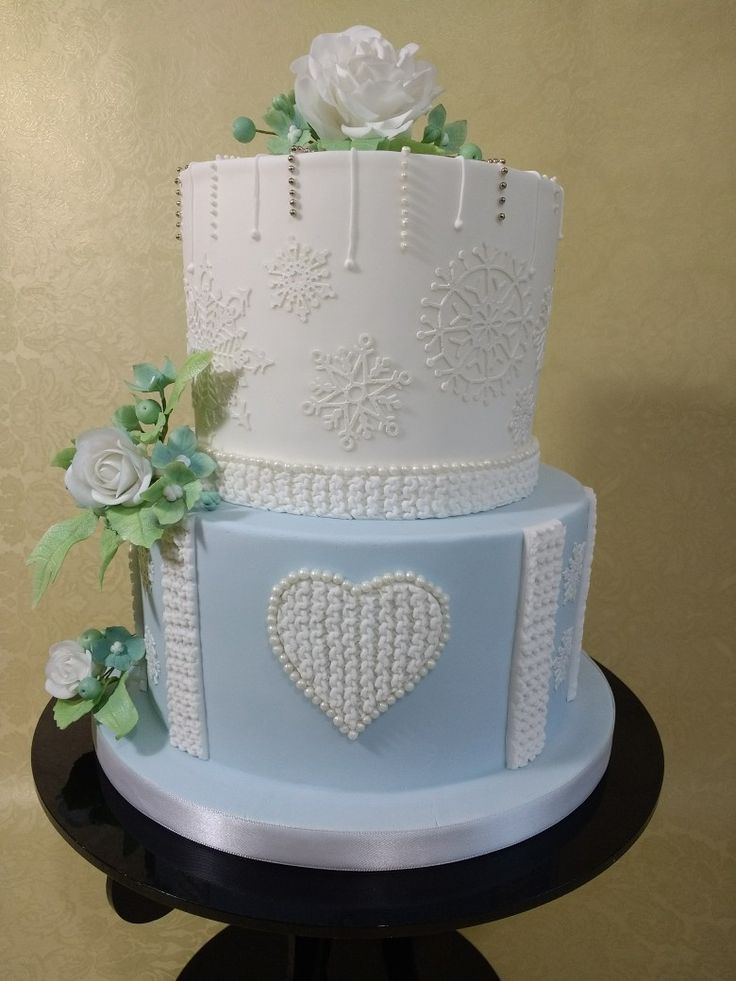 My winter wedding sample cake.  With snowflakes, piping and 'KNITTED' elements.