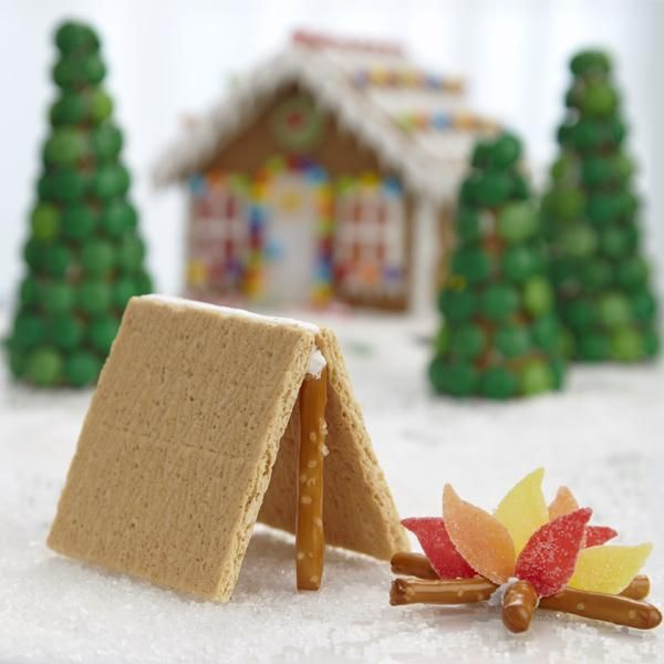 Graham Cracker Tent - Pitching a tent couldn't be easier than it is to make this tent for the backyard of your gingerbread house. Easy-to-make projects like this tent are a great way to personalize your gingerbread scene.