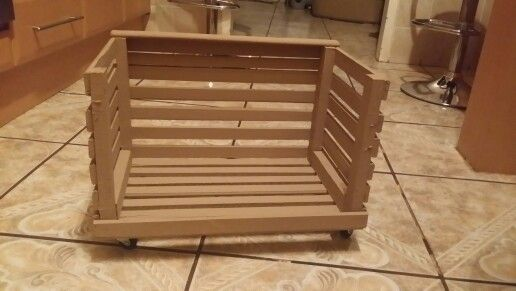 This doggy bed is actually a crate I bought, and took off the front pieces of wood attached wheels and painted the crate