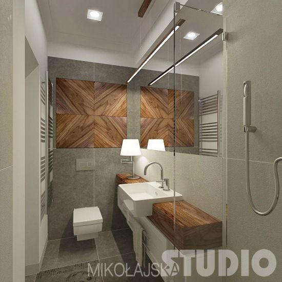 szary betonowy gres na ścianie i podłodze w łazience z drewnianymi dekorami i blatem szafki z umywalką    - Lovingit.pl