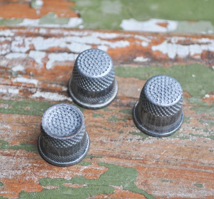 Set of 3 Vintage metal thimbles via Etsy. I need thimbles!