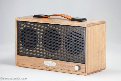 Handcrafted Speaker - Blackbutt gets its name from the rough bark at the tree base which is usually charred black from past bush fires. This Australian native hardwood usually has a straight grain in light brown and varying yellowish tones.  Grain  matched from a single piece of Blackbutt,  fitted with polished     hardware, hand dyed brown leather handle and a black alloy grill.