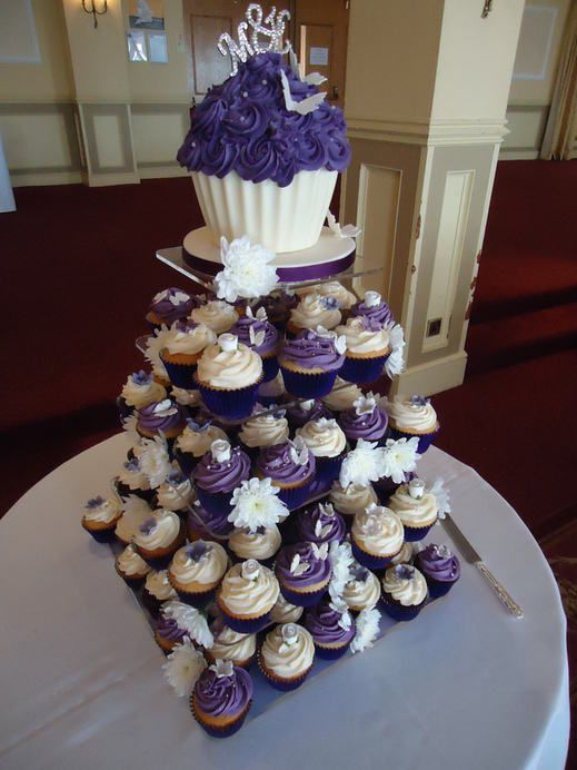 Purple/ivory wedding cupcakes – love the big one on the top! Are these still popular? I love this idea! So pretty!