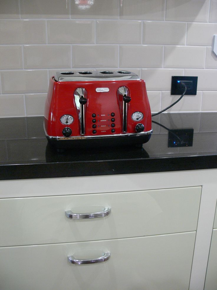 Red Toaster, Black Stone Bench, Beveled Cream Tiles, Two Tone Green  Cupboards.