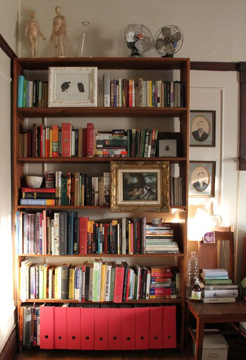 Can you spot the secret storage boxes? Hint - that's not just art on the shelves