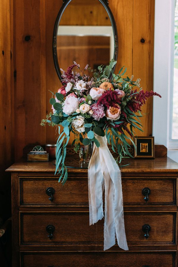 a little much on the greenery, but pretty - wild bouquet - photo by Cara Robbins Photography http://ruffledblog.com/floral-inspired-treehouse-wedding