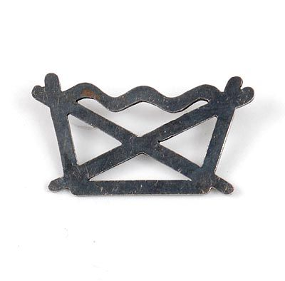 Found on www.botterweg.com - CYNTHIA JACOBS 1965 -  Brooch of blackened silver in the shape of a wash symbol design execution ca.1995 Belgium