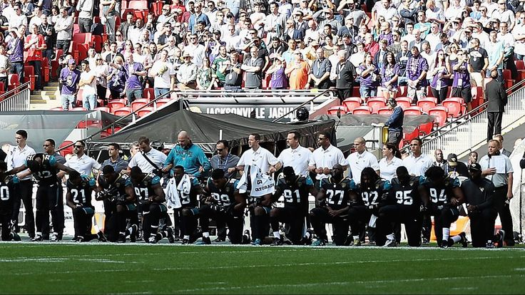 Members of both the Ravens and Jaguars took a knee while the Star Spangled Banner was played ahead of the match-up in London.
