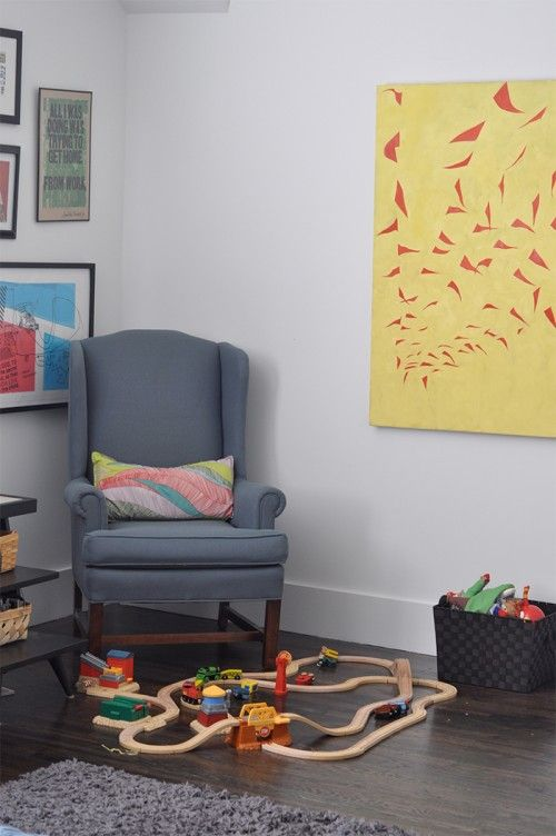 Design Sponge / This corner of the playroom shows an Amos Paul Kennedy print of a Rosa Parks quote and a 2008 painting of mine (red flags).