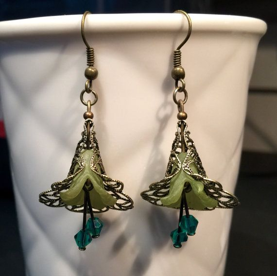 Lovely Vintage style flower dangle earring with lucite flower and crystal beads. Made in bronze and green tones. $10