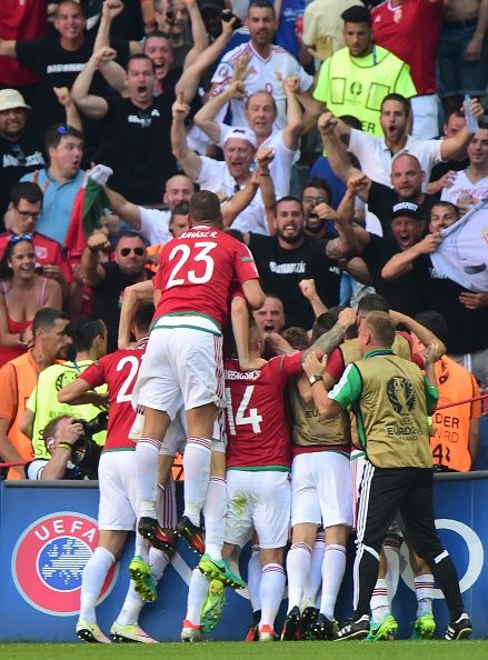 #EURO2016 Hungary's midfielder Balazs Dzsudzsak is congratulated by teammates after scoring a goal during the Euro 2016 group F football match between Hungary...