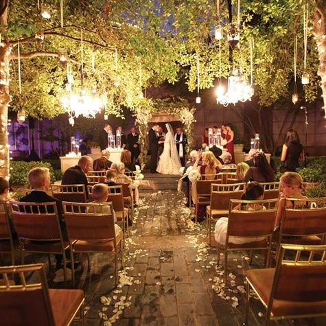 this is beautiful lighting for evening outdoor garden wedding ceremony!