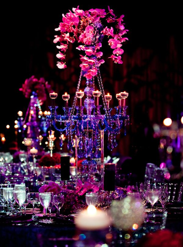 Pink orchid centerpiece with electric blue candleabra
