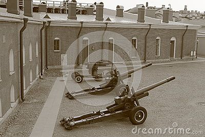 The territory of the Naryshkin bastion of the Peter-Pavel's Fortress on Hare Island. Two howitzers and anti-aircraft gun of the Soviet period, are used as instruments of salutes. Saint-Petersburg, Russia