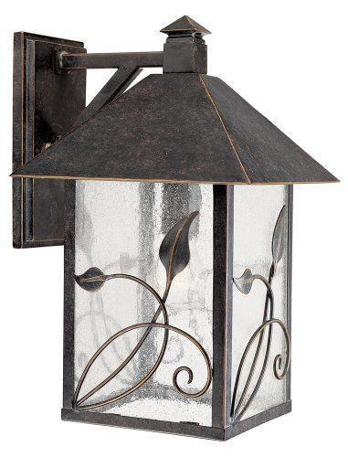 """French Garden Collection 15"""" High Outdoor Wall Light by Unknown. Save 33 Off!. $139.99. As part of the French Garden Collection, this outdoor wall light has stems and leaves gently scrolling upward. Features a warm French bronze finish and clear seedy glass. From Franklin Iron Works®."""