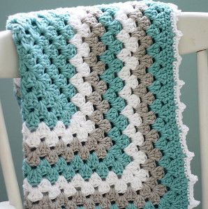 Give your baby a little taste of the ocean with the Sea Spray Granny Baby Blanket. With its cool blue shades, this crochet granny square blanket is great for any little boy or girl!  | AllFreeCrochetAfghanPatterns.com