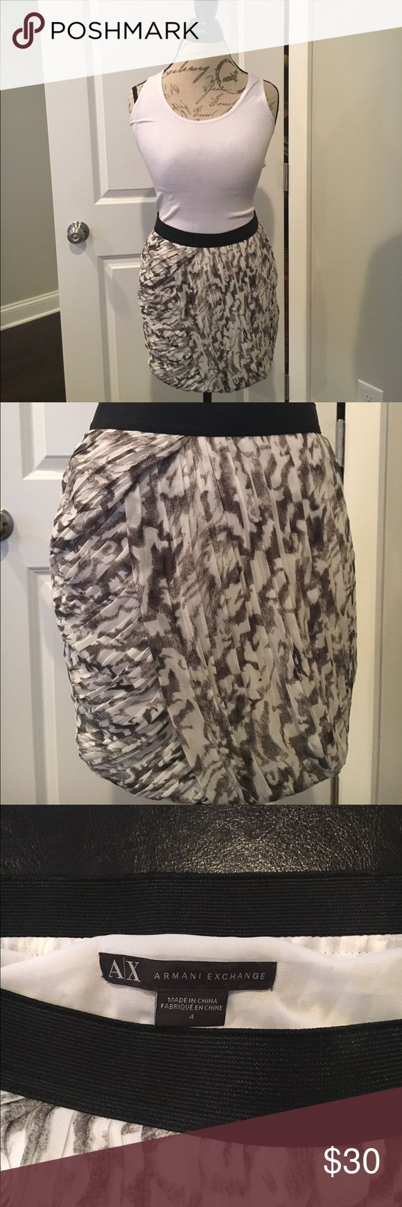 "Armani Exchange Skirt Beautiful black and white by Armani Exchange. Size 4 and measures about 15"" from the top of waistband to bottom of skirt.  Black elastic waist band for comfort and a side zip with clasp for closure. Armani Exchange Skirts"