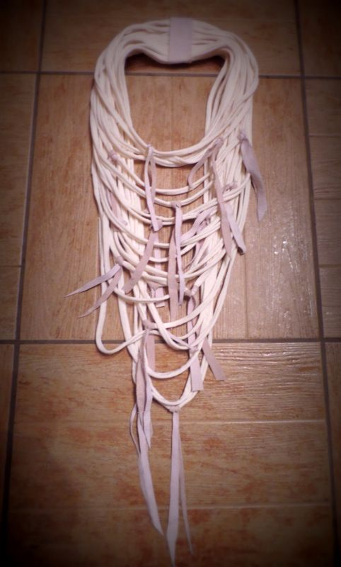 Handmade cotton necklace with pieces of leather.