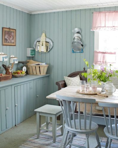 Swedish summer cottage with painted blue pine walls and furniture. <3 the red polkadot curtains. The woven rugs on the floor tie all the colors together.