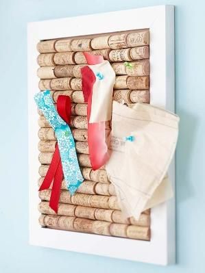 Make a Wine Cork Board - perfect handmade gift for a wine lover. A wine cork base makes a bulletin board both functional and artsy. Choose a frame deep enough to hold whole corks, or cut the corks in half lengthwise. Glue down. Add a few favorite pictures to make your gift extra special. by essie