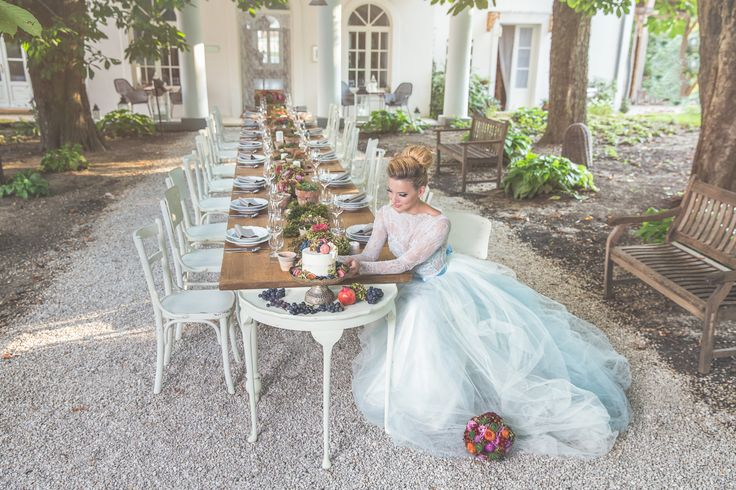 Beautiful bride and a lovely rustic style wedding table