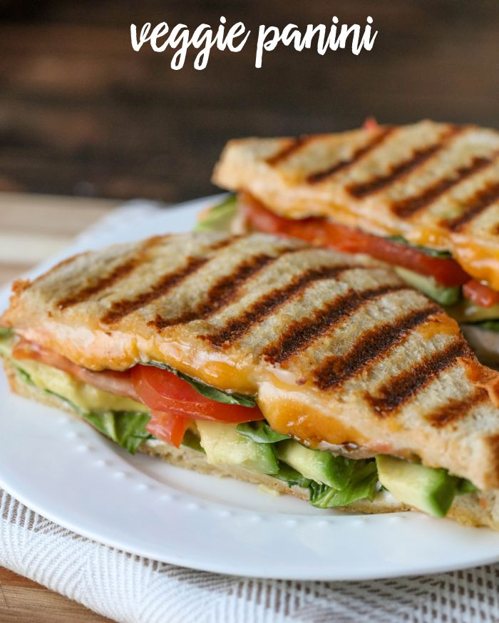 Delicious Veggie Panini - one of our favorite sandwich recipes filled with cheese, tomatoes, avocado and spinach.