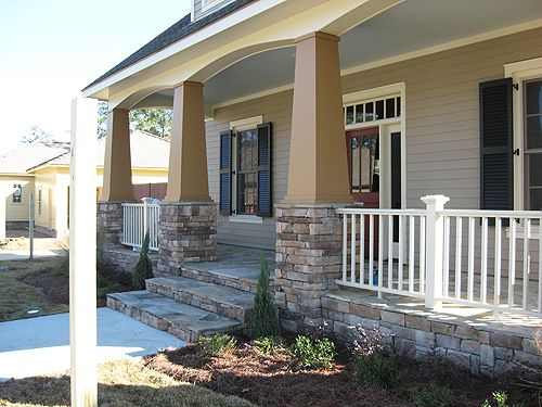Front Steps Designed With Stone Stucco Columns And