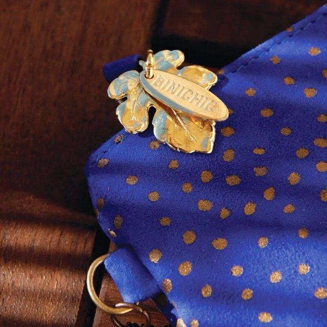 Signature #binichic oak leaf charm adorns our #Justine bag in Snow Blue