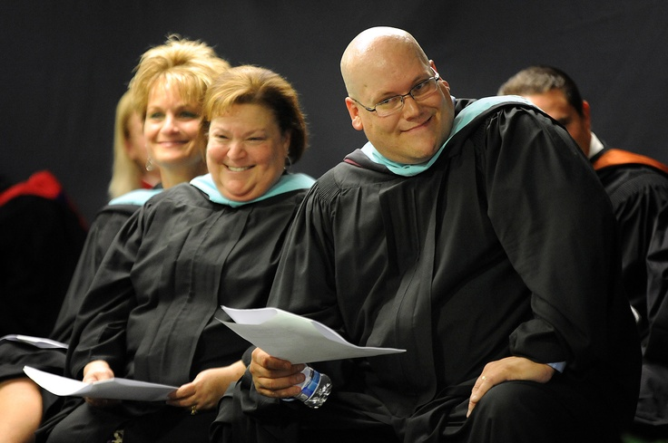 Principal David Knoche smiles during a commencement ceremony May 17 at Falcon Virtual Academy in Falcon School District 49. Thirty-six of the 39 students who graduated with the class of 2013 attended the ceremony at the blended-learning center in Colorado Springs.