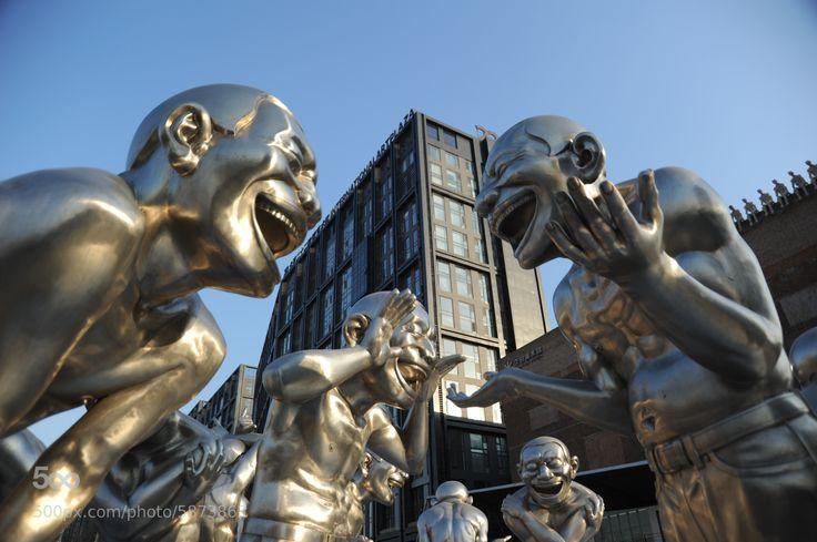Sculptures by Yue Minjun in front of Pingod Development Beijing