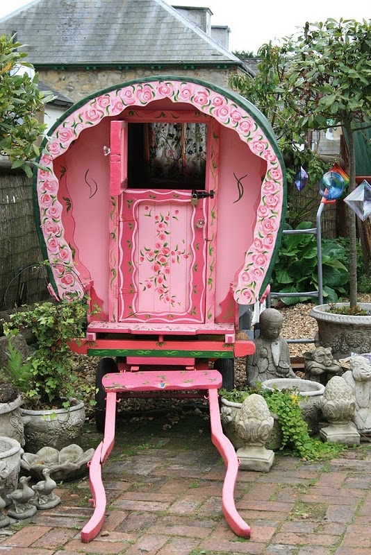 pink gypsy caravan - I so want one of these tucked back in a far corner of my property.  What a great place to go and cozy up and read!