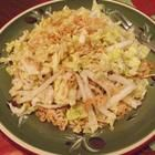 Napa Cabbage Salad:    Ingredients    1 head napa cabbage  1 bunch minced green onions  1/3 cup butter  1 (3 ounce) package ramen noodles, broken  2 tablespoons sesame seeds  1 cup slivered almonds  1/4 cup cider vinegar  3/4 cup vegetable oil  1/2 cup white sugar  2 tablespoons soy sauce