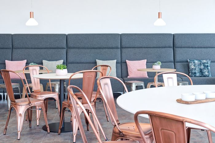Copper Chairs in the break area at the Uber Offices - London - Office Snapshots