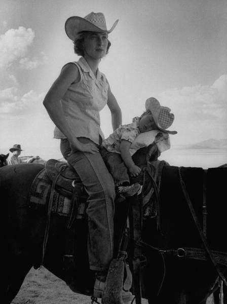 jean anne evans, a 14-month-old texas girl, falling asleep on a horse with her mother, billy anne, on the set of the film giant, marfa, tx, july 1955 • allan grant for life magazine