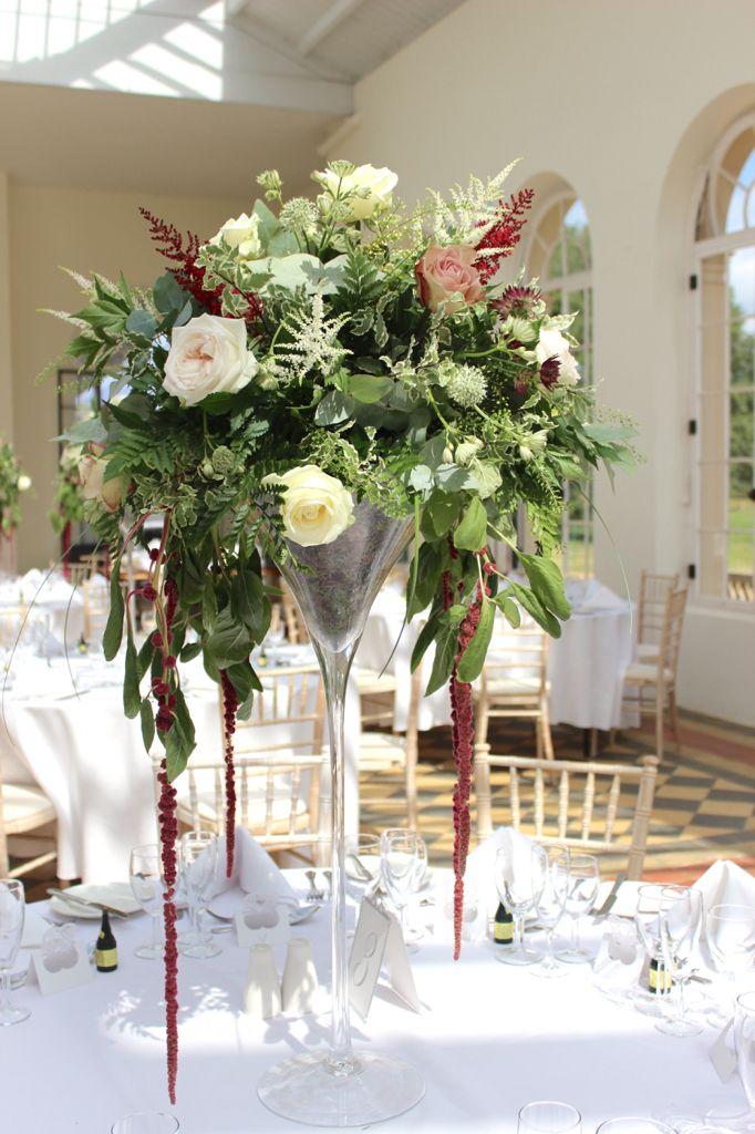 Martini vase display at wrest park orangery.  Wedding flowers at wrest park with amaranthas, roses, astilbe, astrantia fern