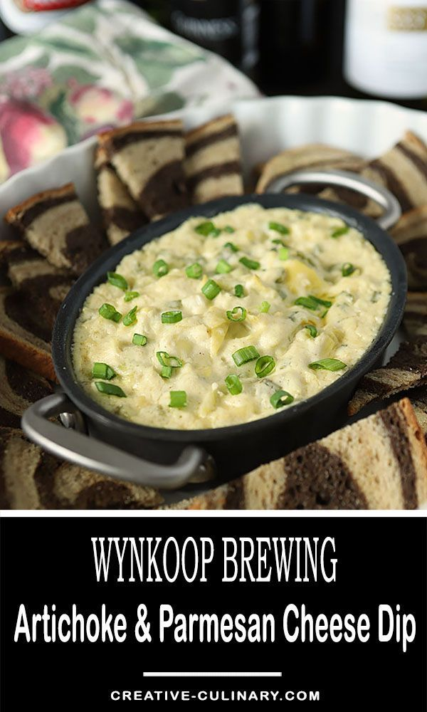 The perfect appetizer for your game day TV viewing; this Wynkoop Brewing Artichoke and Parmesan Cheese Dip is warm and savory and perfect served with some toasted rye and pumpernickel bread. via @creativculinary